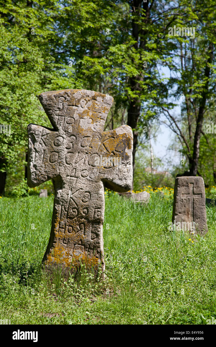Cross on the prehistorical grave - Stock Image