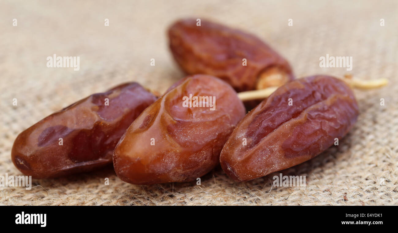 Fresh date on sack with selective focus - Stock Image