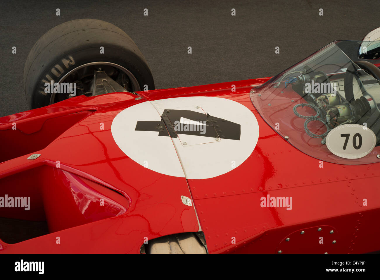 Number 4 on a red Formula 1 race car. - Stock Image