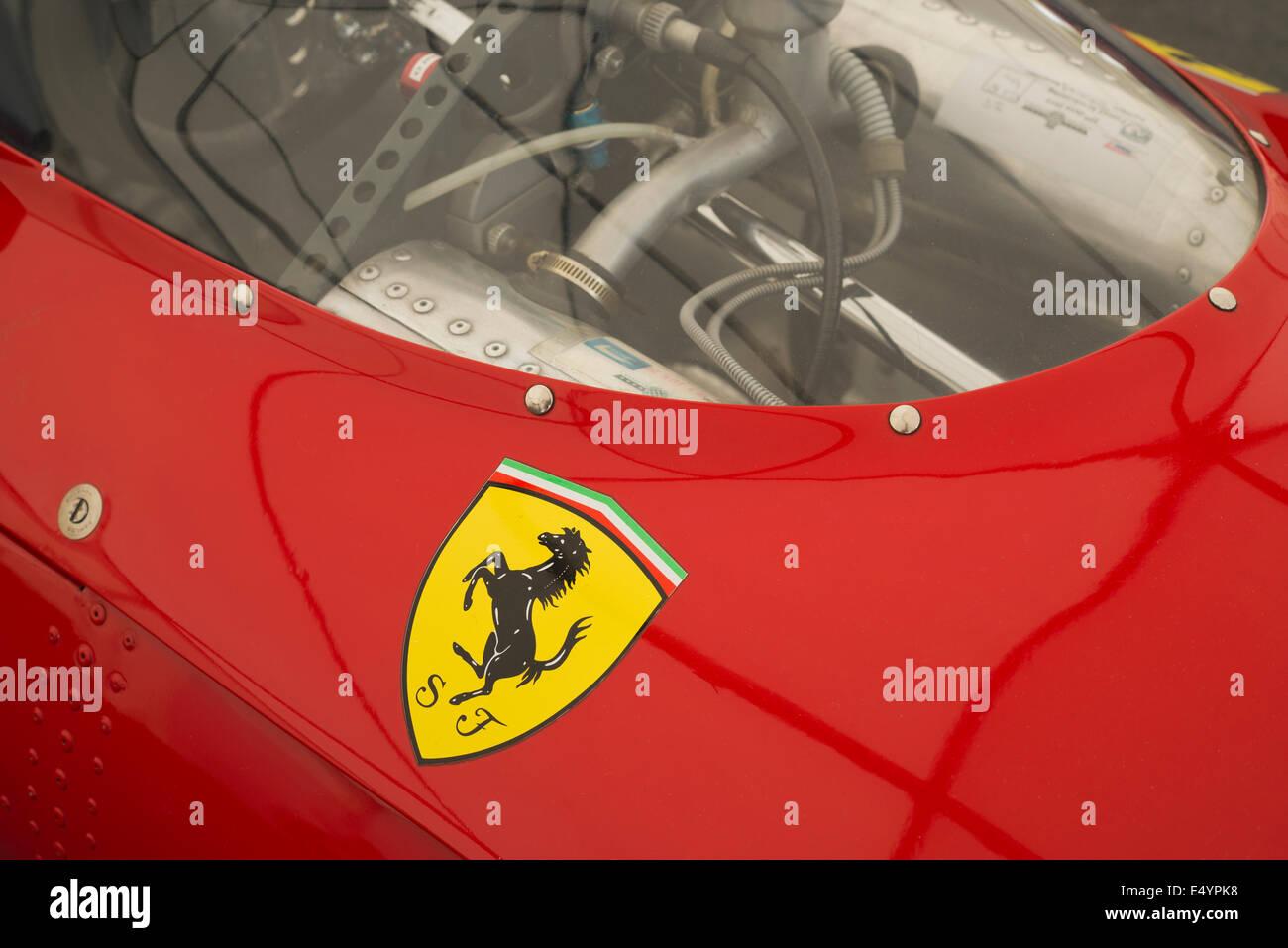 Ferrari prancing horse logo on a red racing car - Stock Image