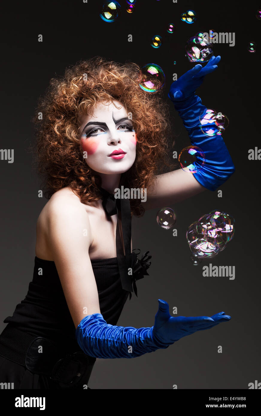 woman mime with soap bubbles. - Stock Image