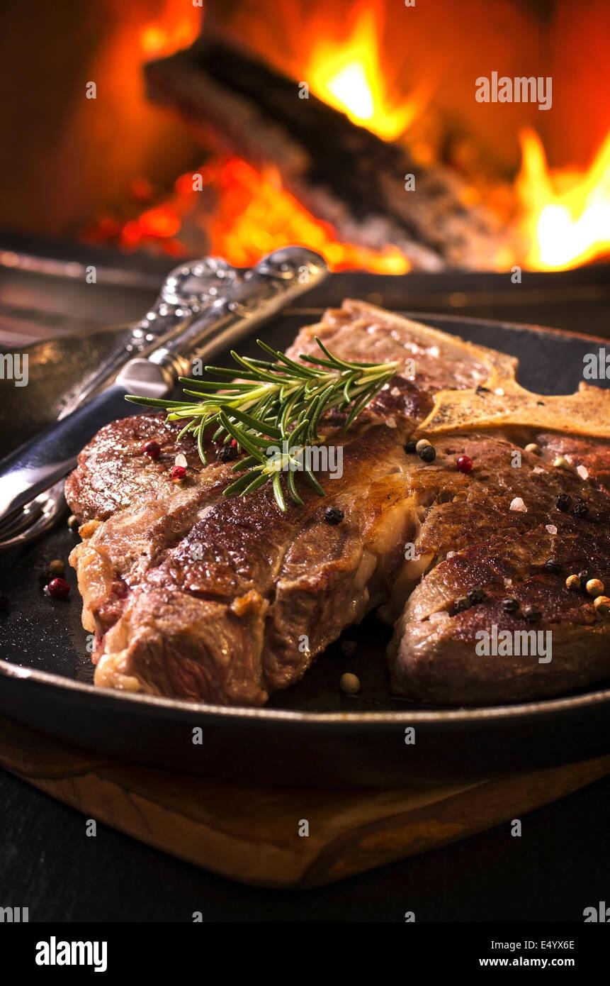 t-bone steak in the frypan - Stock Image