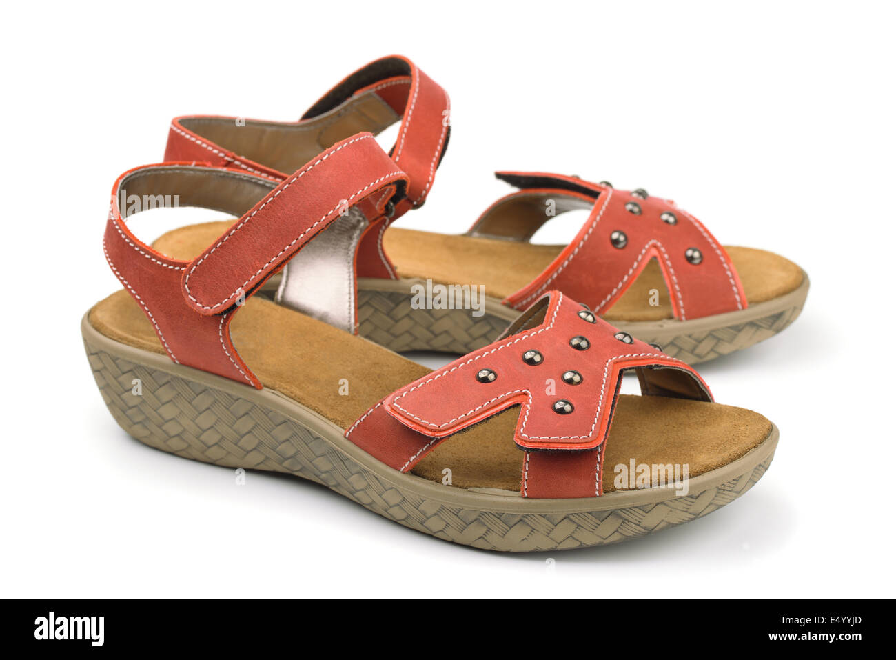 Red leather sandals isolated on white - Stock Image
