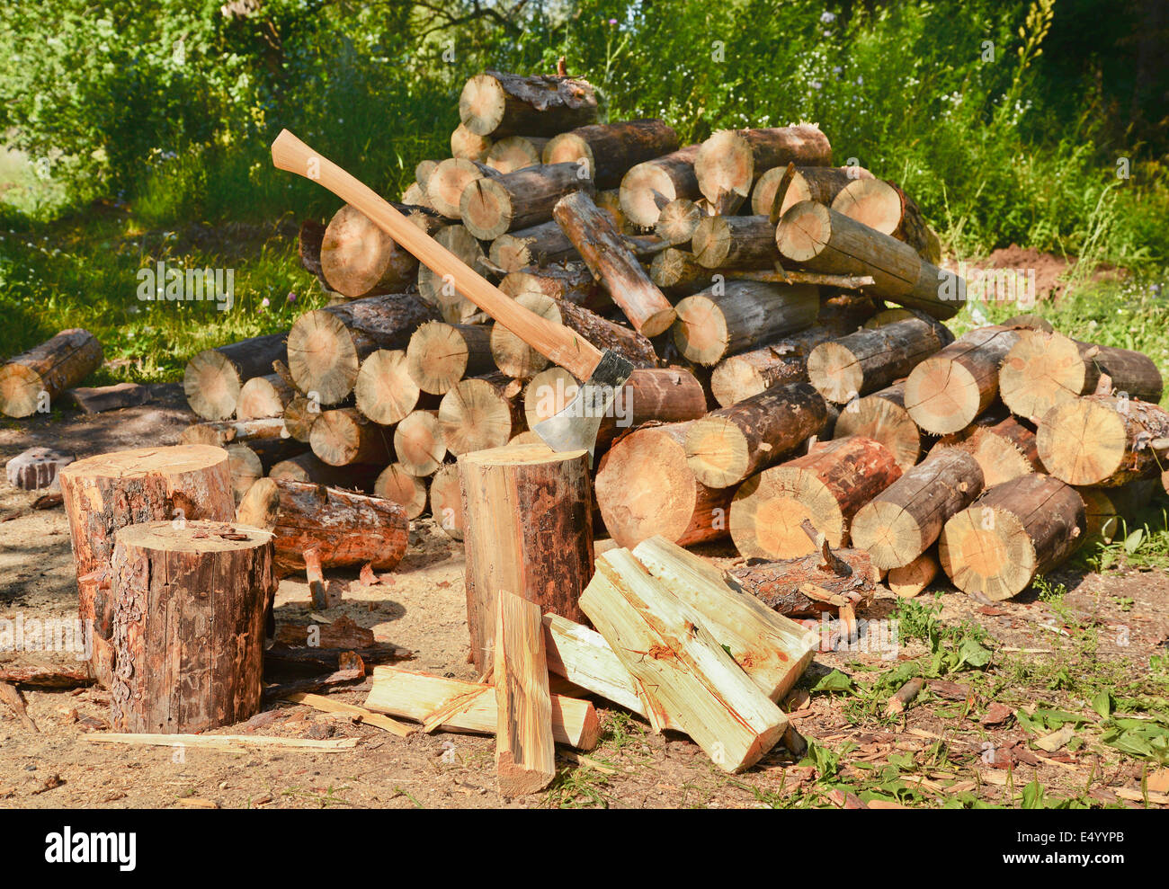 Pile of firewood and axe - Stock Image