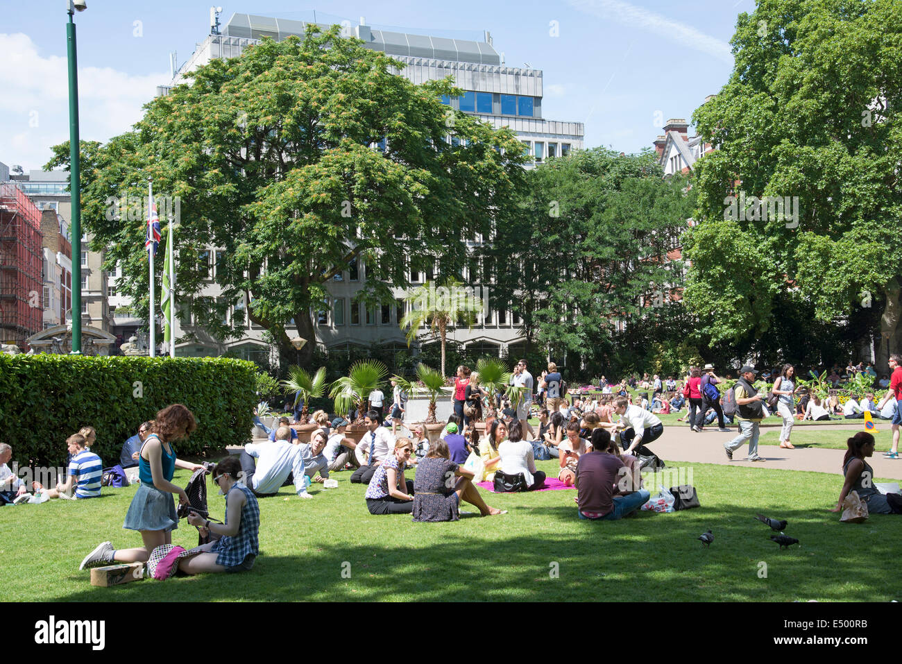 Summer Day In The Victoria Embankment Gardens London Uk People Stock