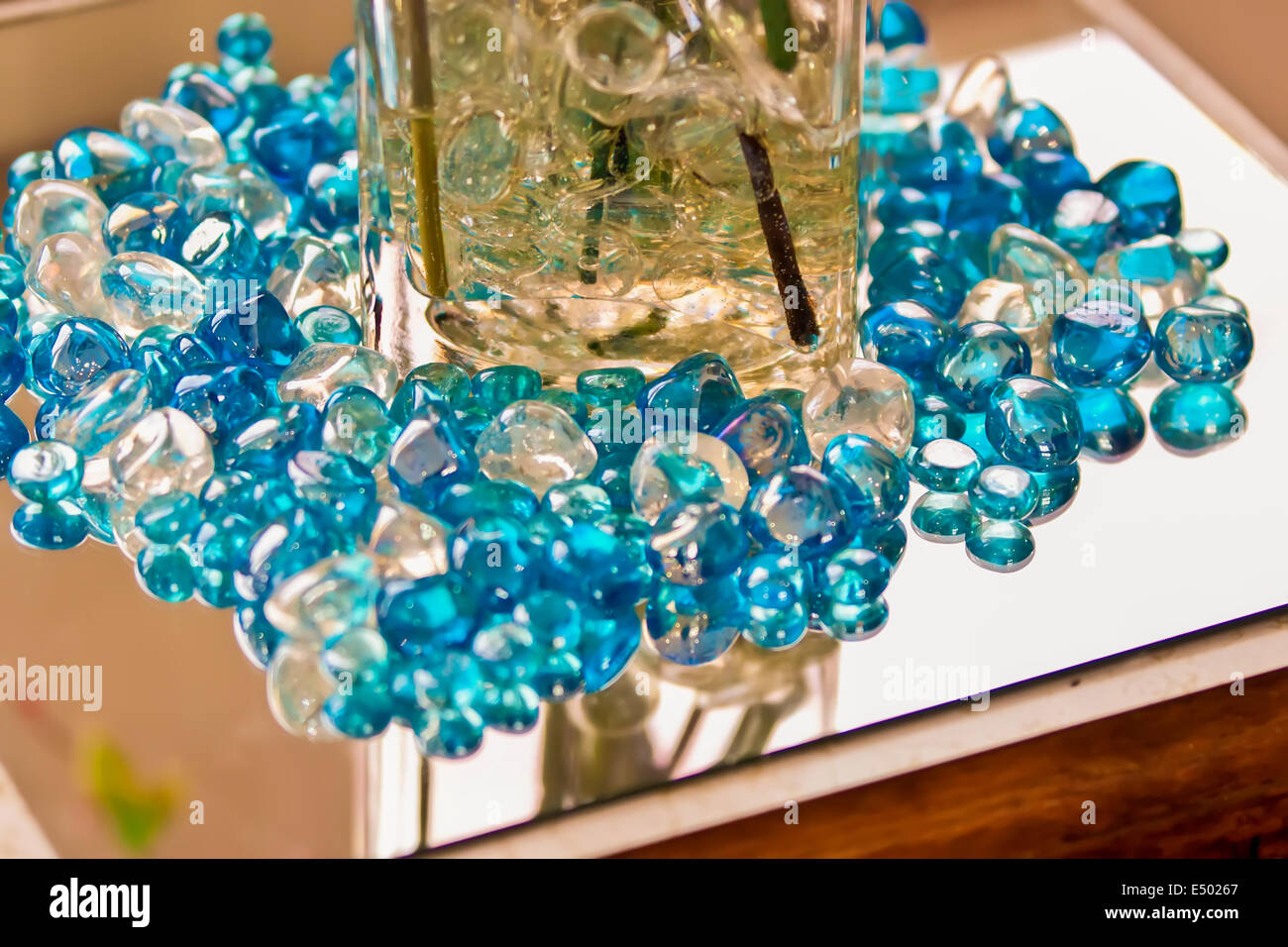 blue marbles on a reflective surface Stock Photo