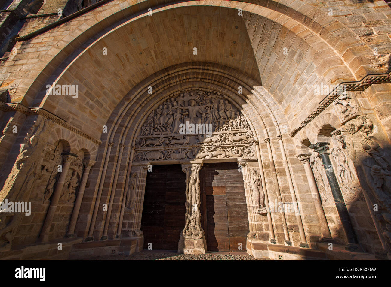 Romanesque tympanum portico Benedictine Abbey Cluniac monastery Moissac France - Stock Image