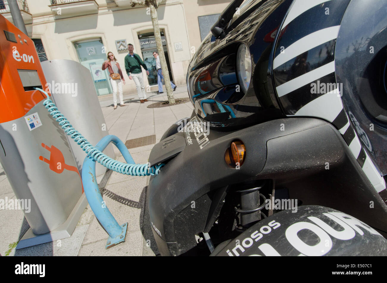 A Renault Twizy electric car gets its battery recharged at an E.on street-side charging station on the Santander Stock Photo