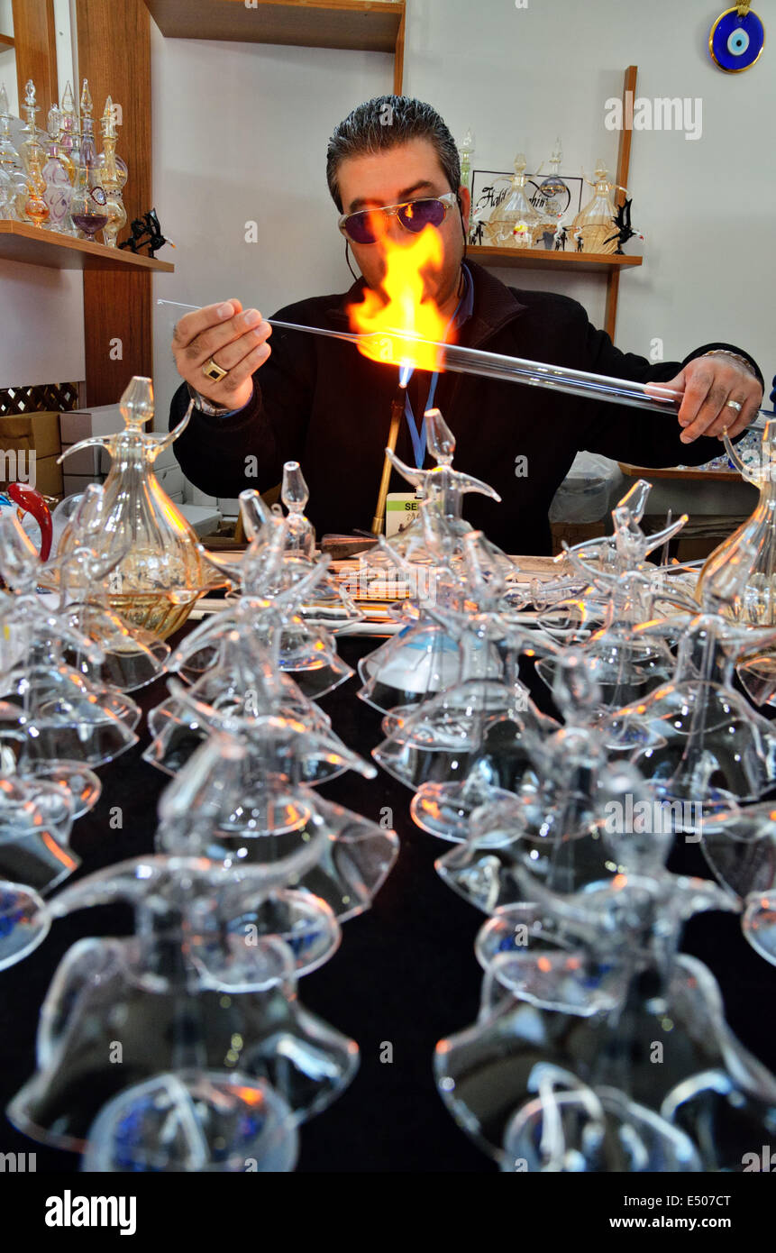 Glassblower makes glass figures of whirling dervishes, Konya, Turkey - Stock Image