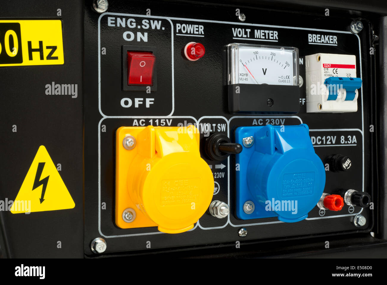 Electricity generator control panel;  with sockets, Volt meter, switches and circuit breakers. Stock Photo