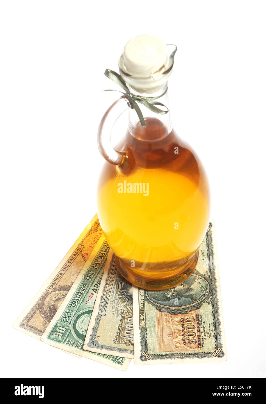 Oil bottle and Greece drachmas - Stock Image