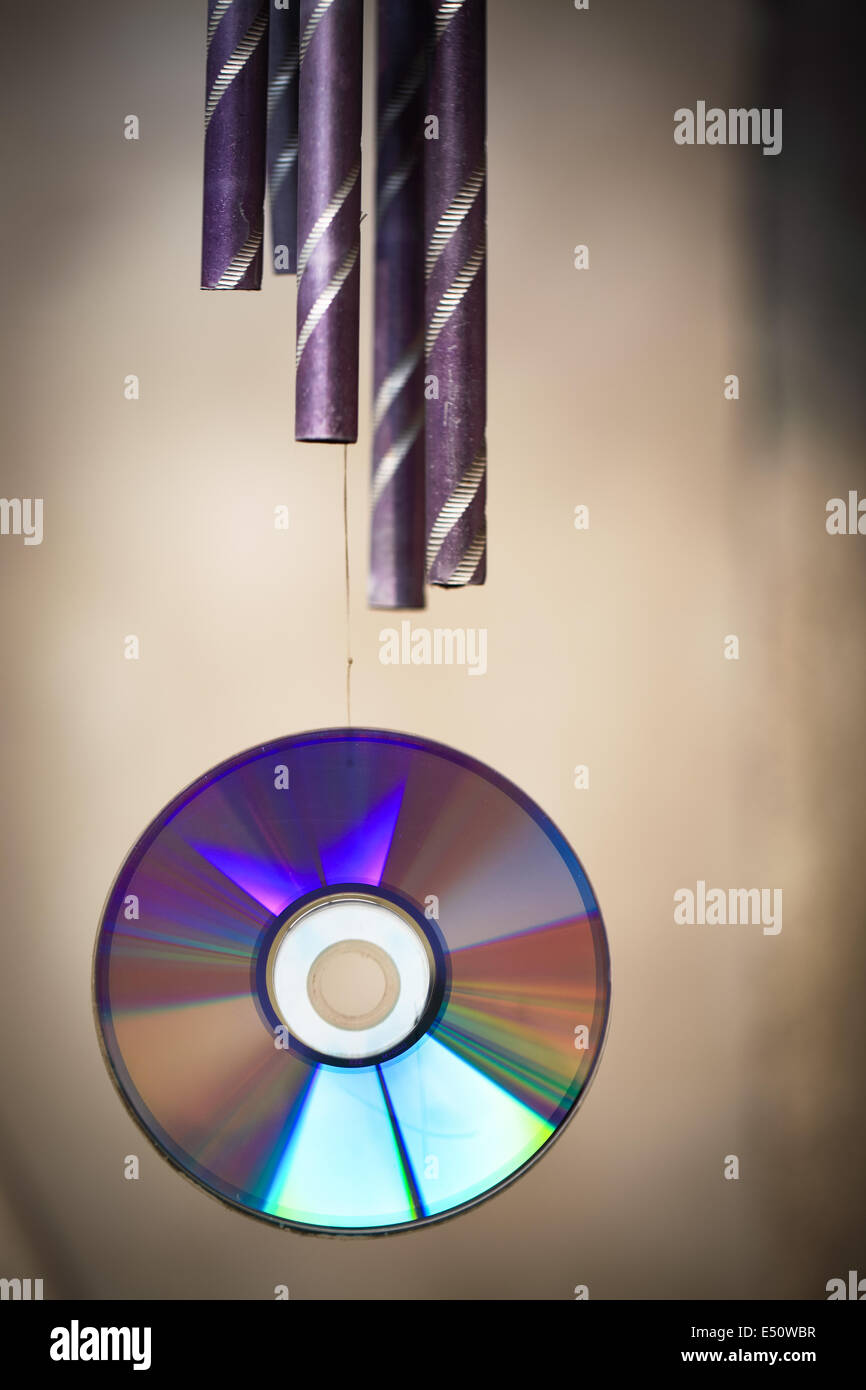 wind chime and cd rom - Stock Image