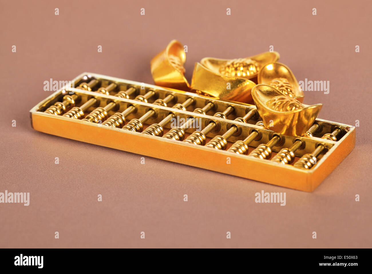 chinese gold ingot and golden abacus - Stock Image