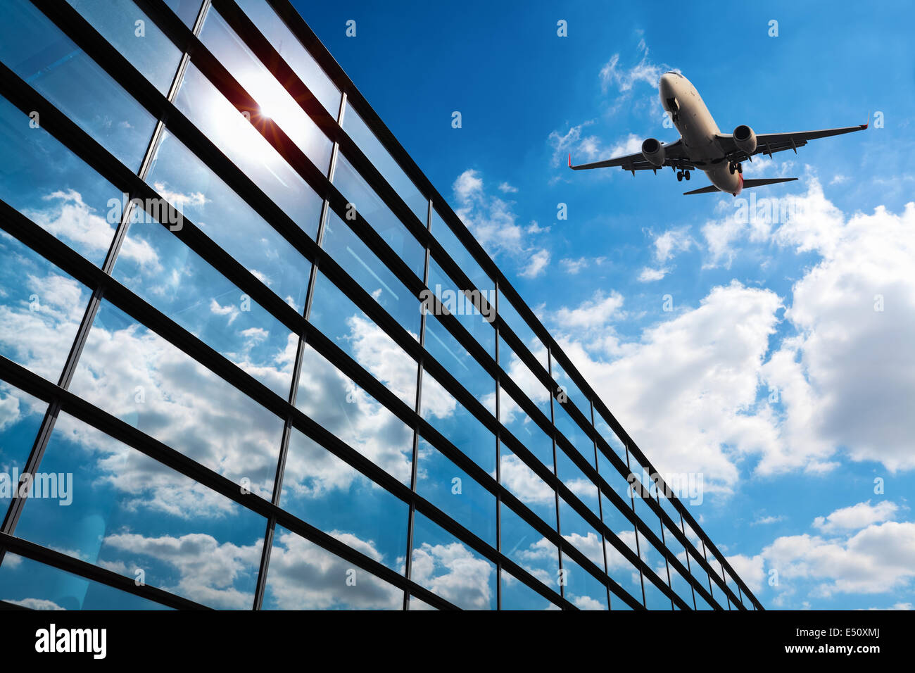 glass curtain wall and aircraft Stock Photo