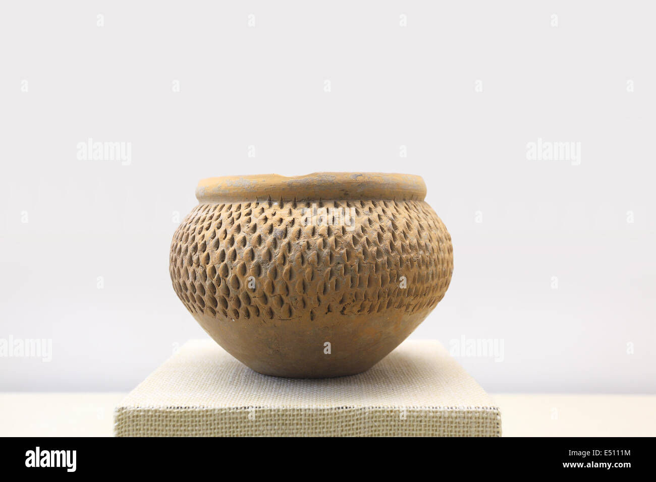primitive earthen jar - Stock Image