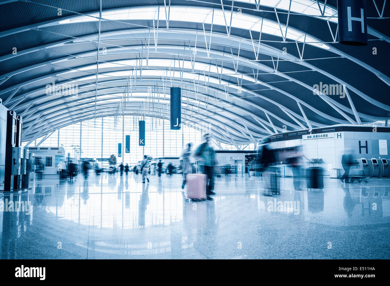 airline passengers in the airport - Stock Image