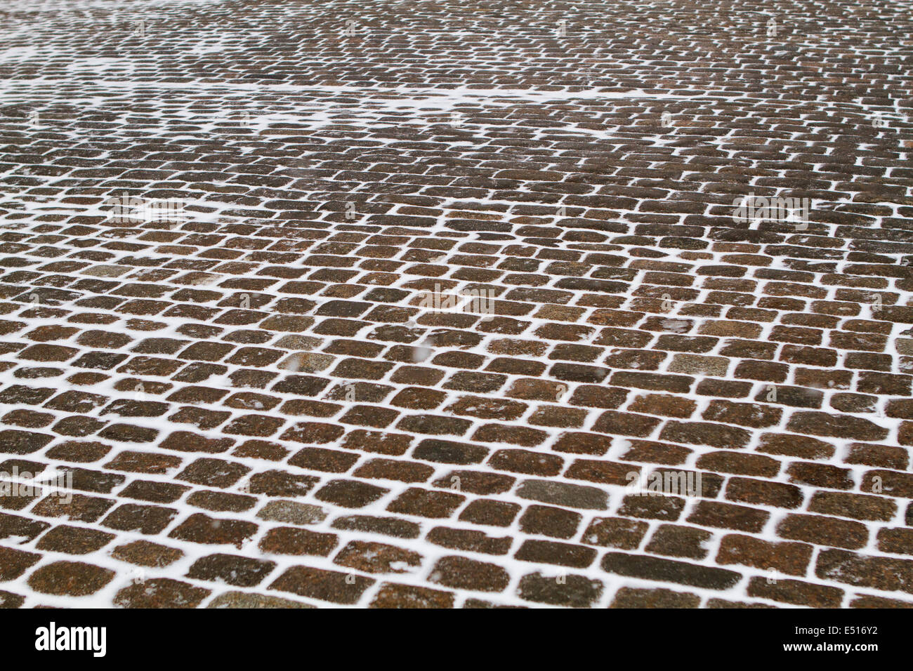 Closeup view on a cobblestone road pattern - Stock Image