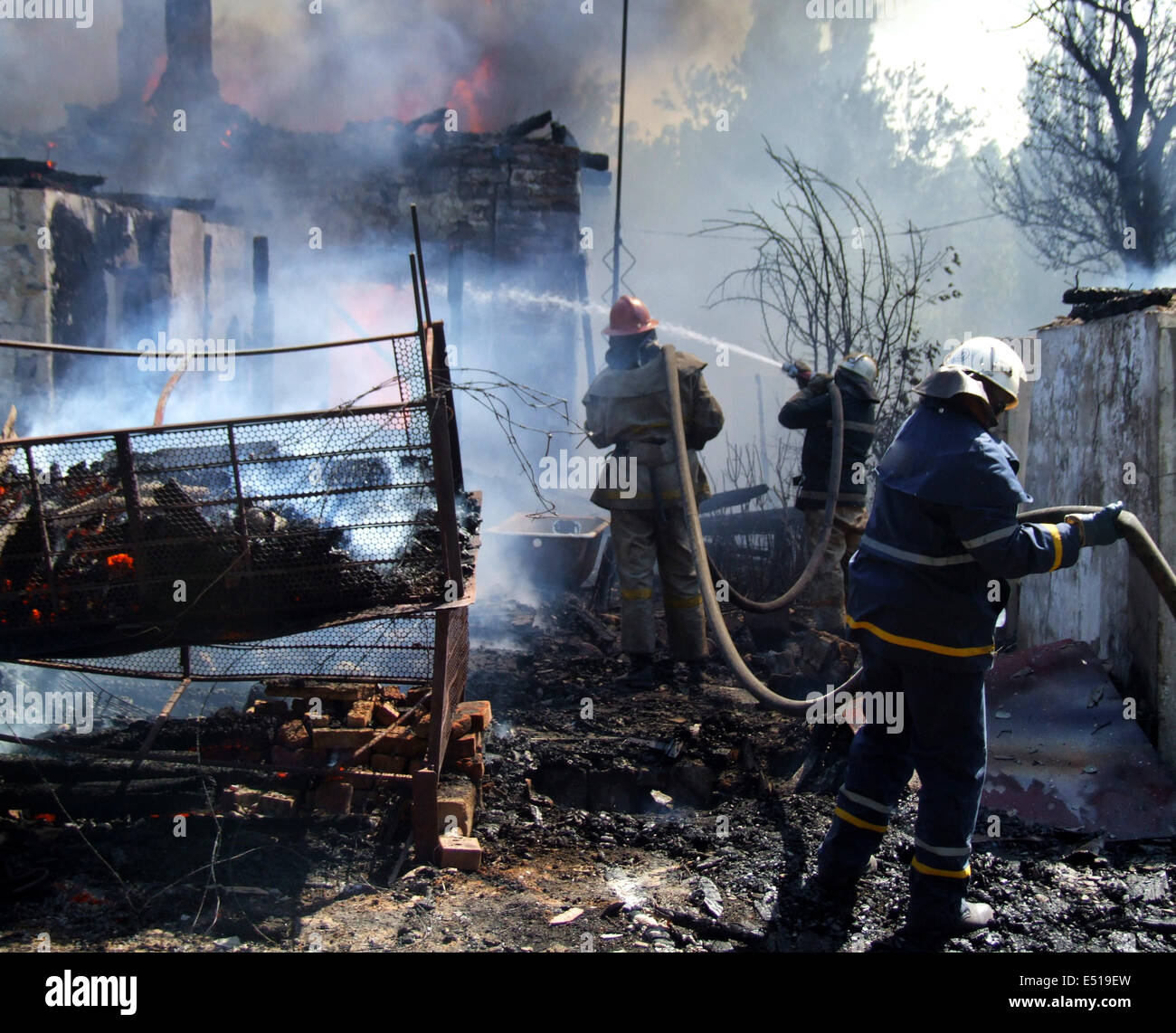 firefighters extinguish a fire - Stock Image