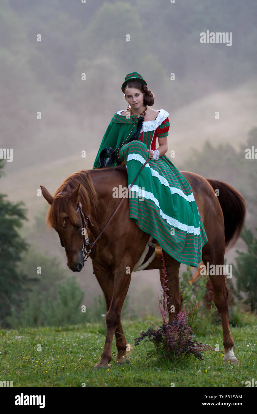 Girl riding equestrian classicism dress - Stock Image
