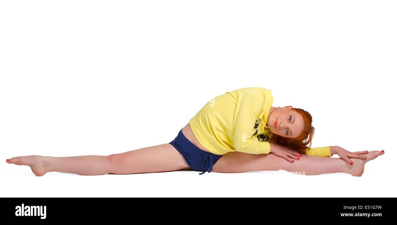Pretty flexible dancer woman sit on twine - Stock Image