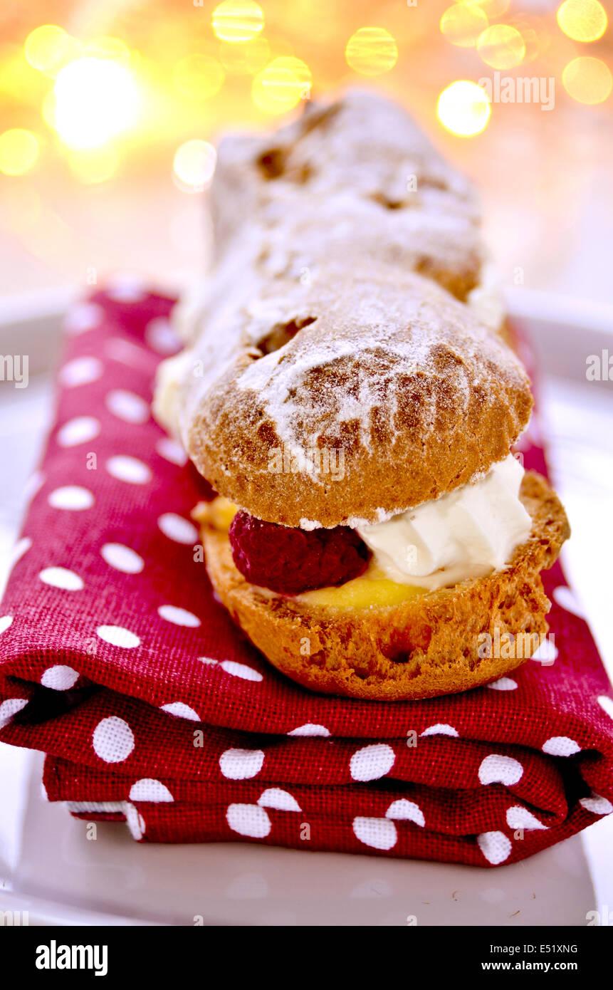Choux pastry cream eclair slice - Stock Image