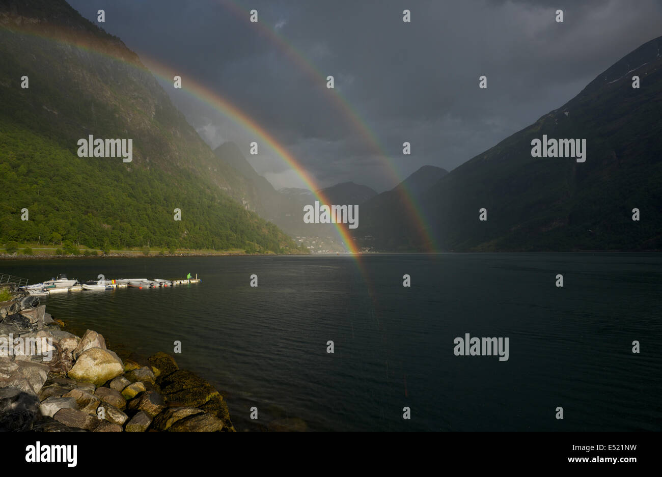 Rainbows over Geiranger Norway - Stock Image
