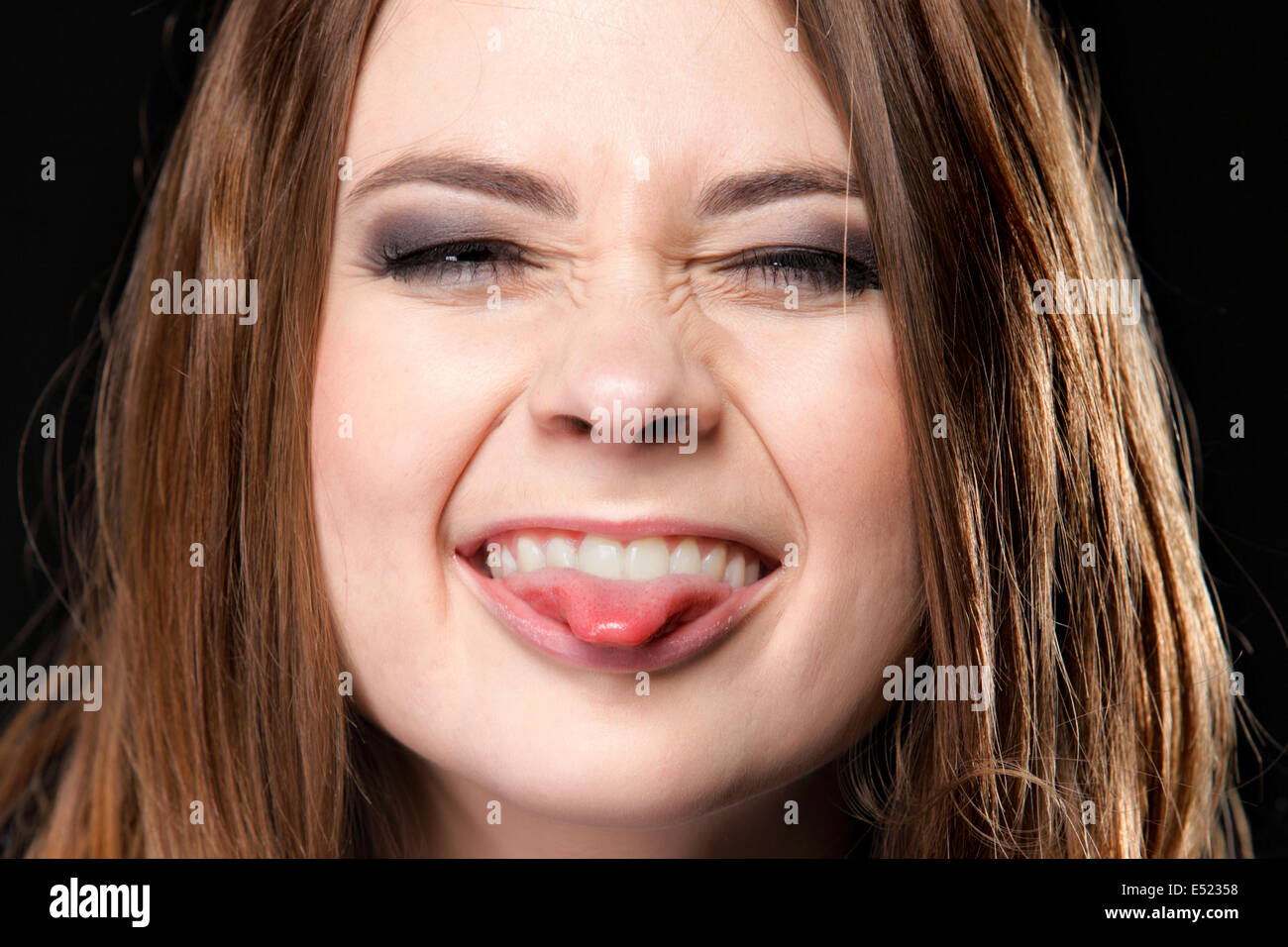Grimacing. Young Woman Making Silly Face. - Stock Image