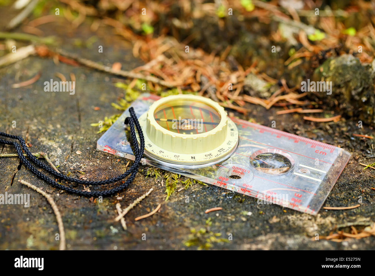 old touristic handheld compass on groung outdoor - Stock Image