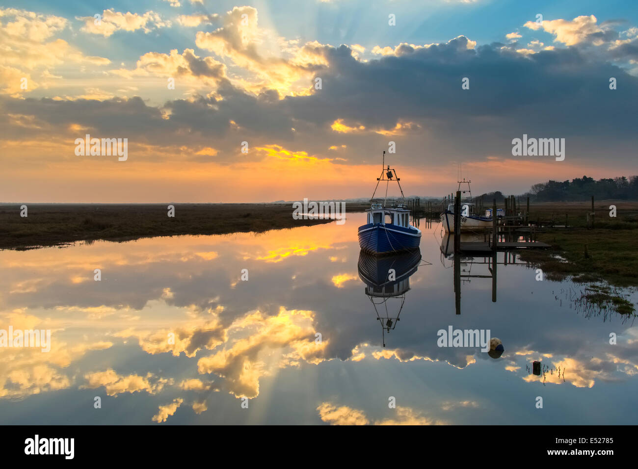 Calm waters of a high spring tide at sunrise. - Stock Image