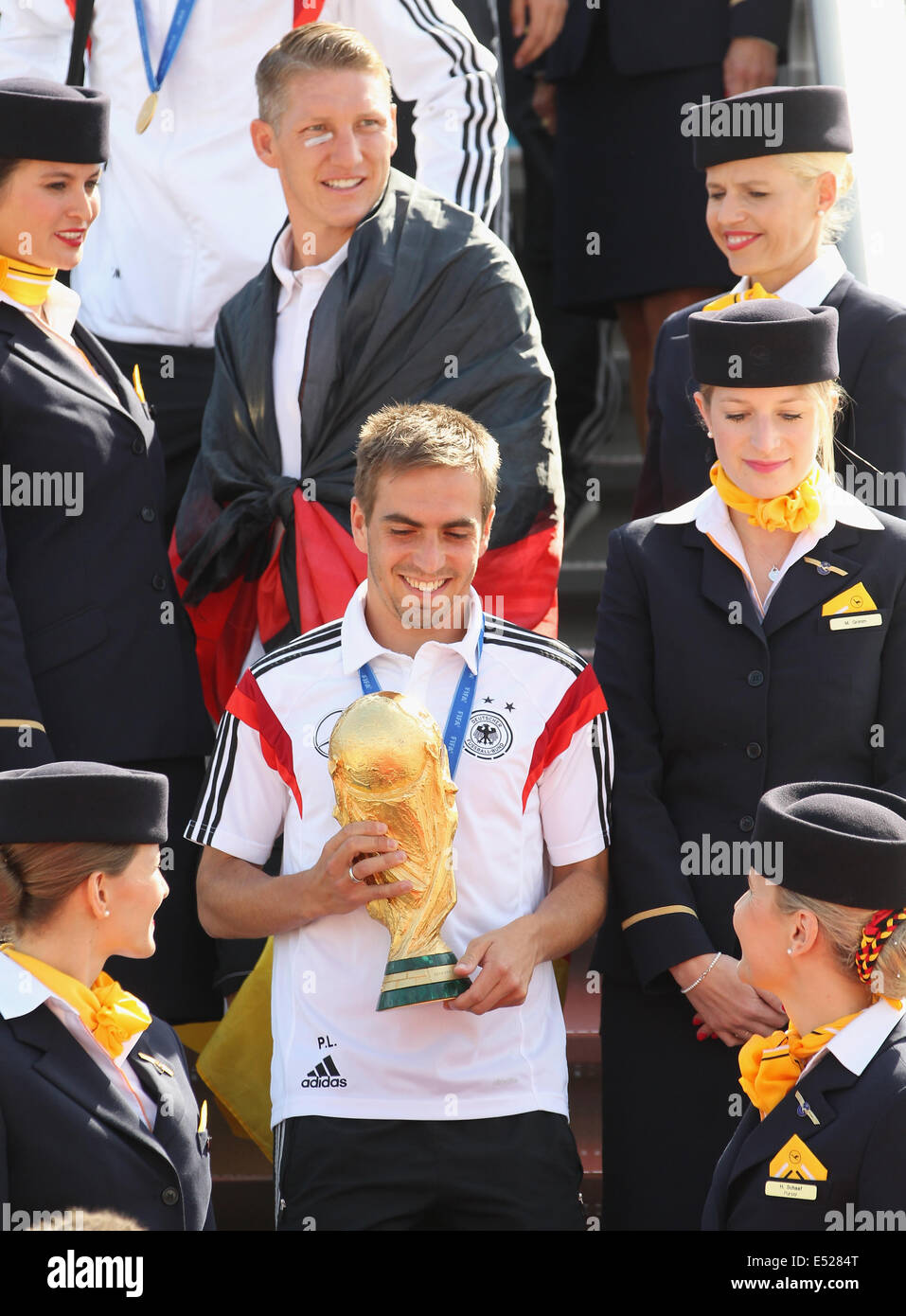 Germany captain Philipp Lahm returns with the World Cup trophy. On Friday it was confirmed Lahm had decided - Stock Image