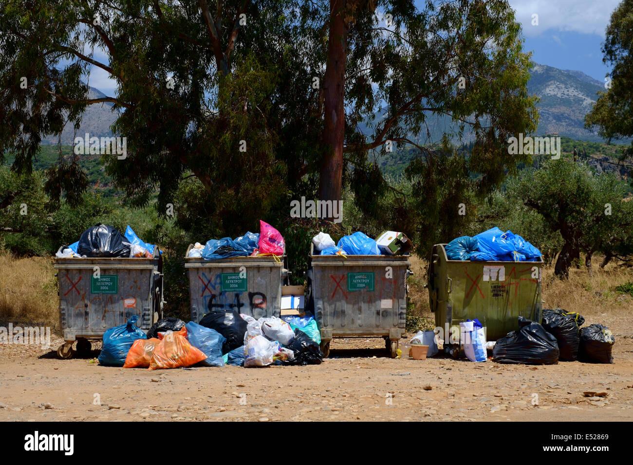 MANI PENINSULA, MESSINIA, PELOPONNESE, GREECE, 14th July 2014. Communal rubbish bins - Stock Image