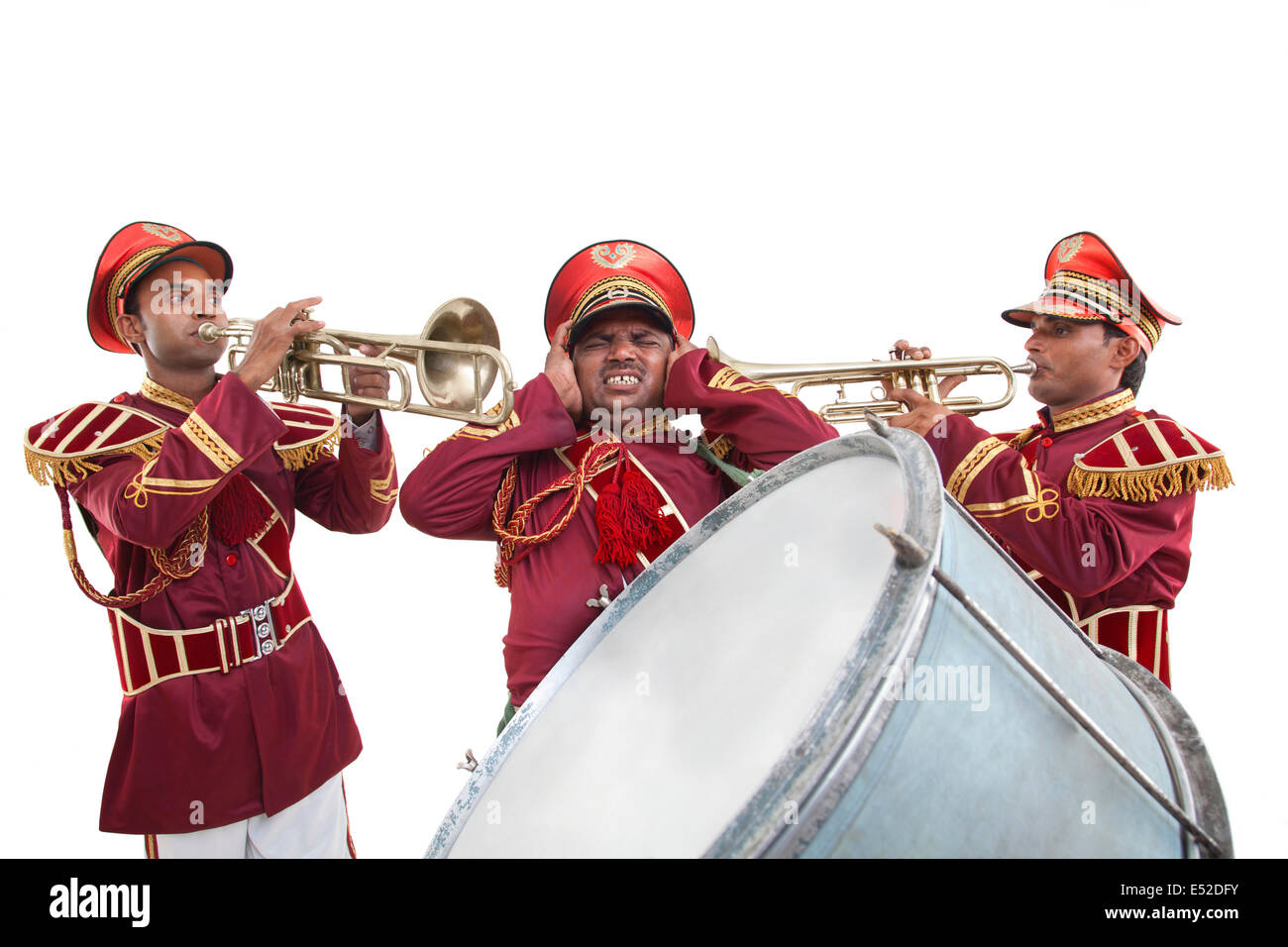 Bandwala shielding his ears from the noise - Stock Image