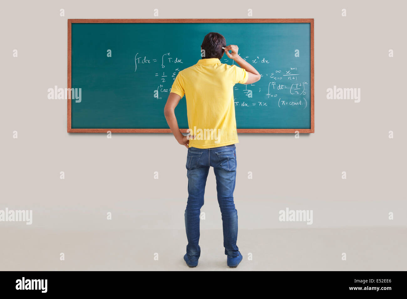 College student trying to solve a maths equation - Stock Image