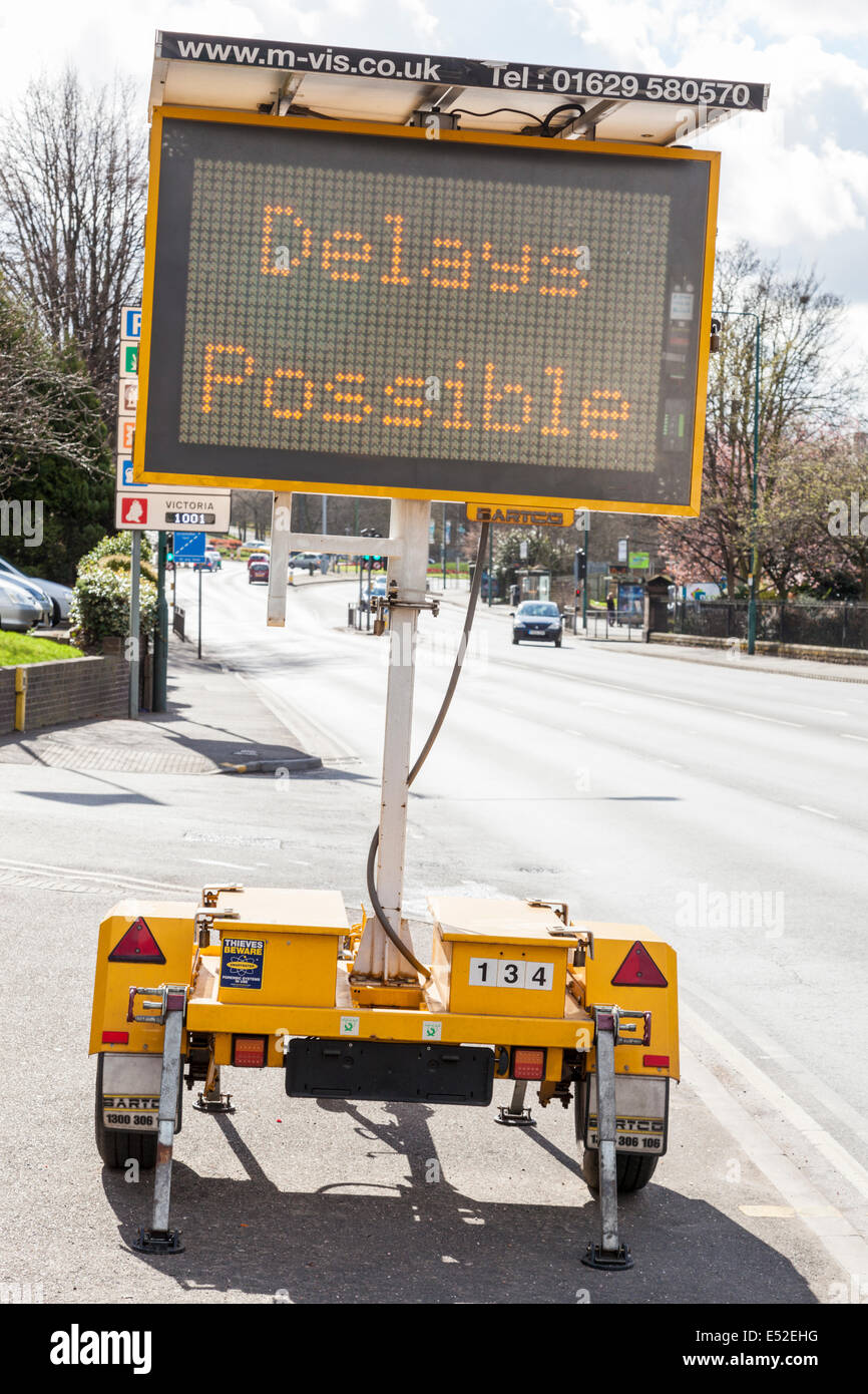 Solar powered mobile matrix traffic sign warning of delays in Nottingham, England, UK - Stock Image