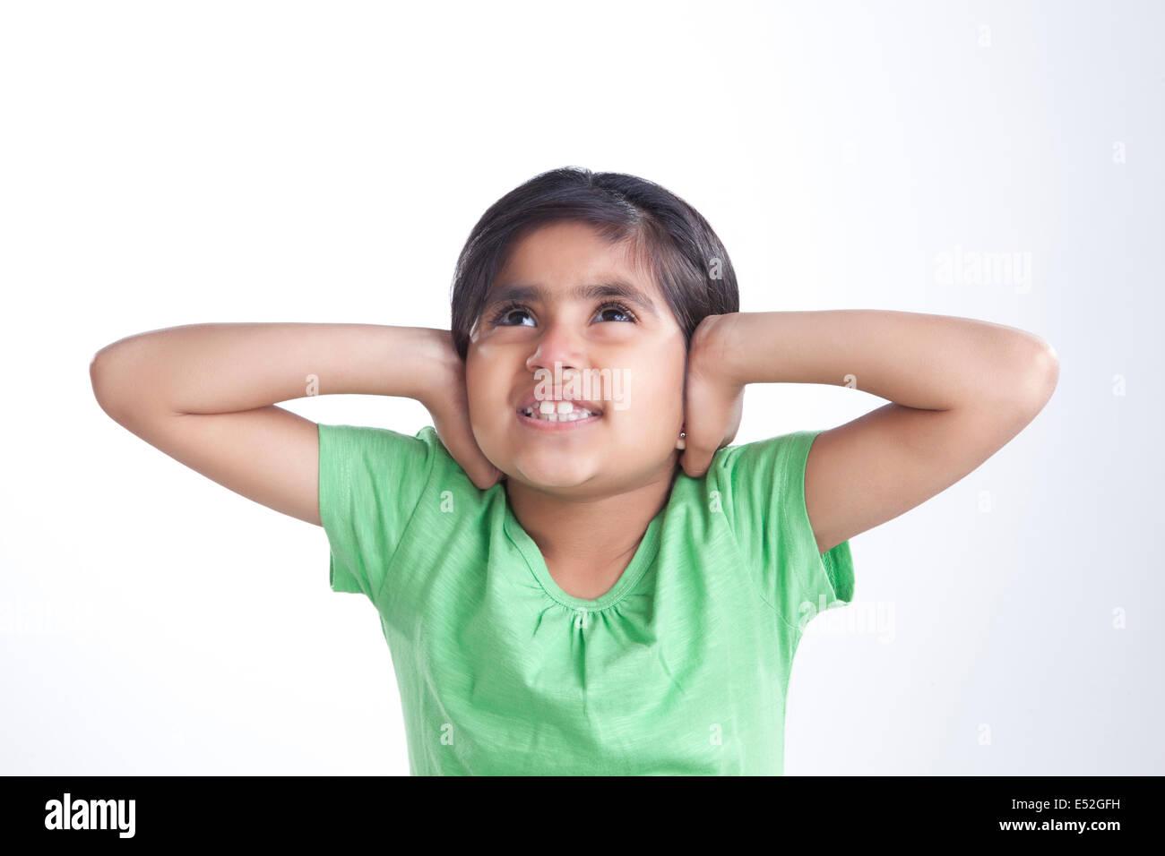 Little girl covering her ears - Stock Image