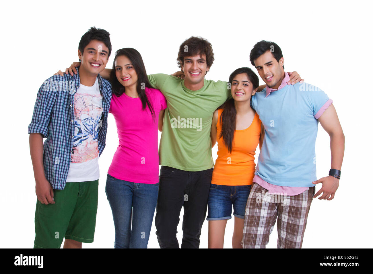 Portrait of young friends in casuals standing together isolated over white background - Stock Image