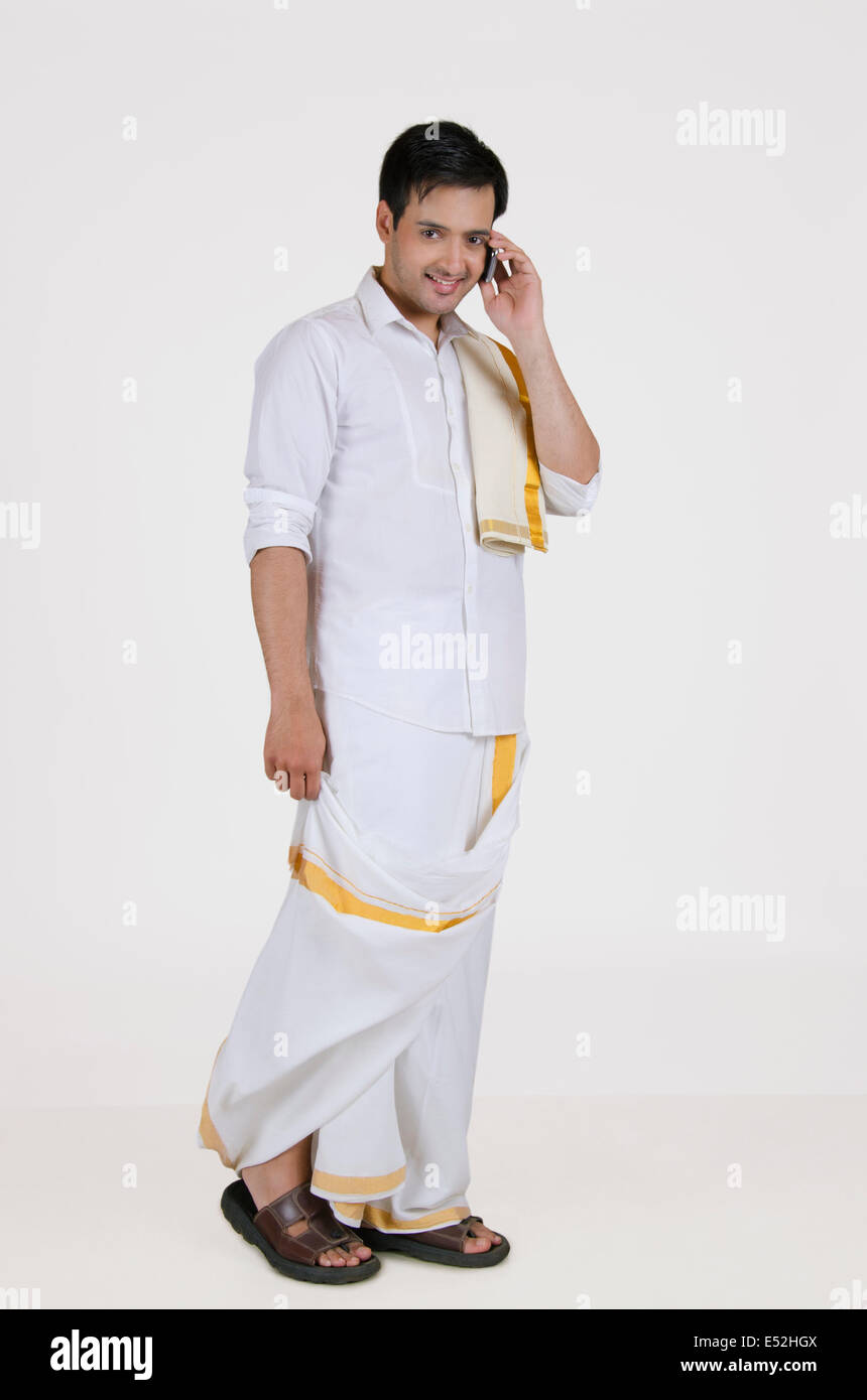 18239c4b6b Portrait of a South Indian man talking on a mobile phone Stock Photo ...