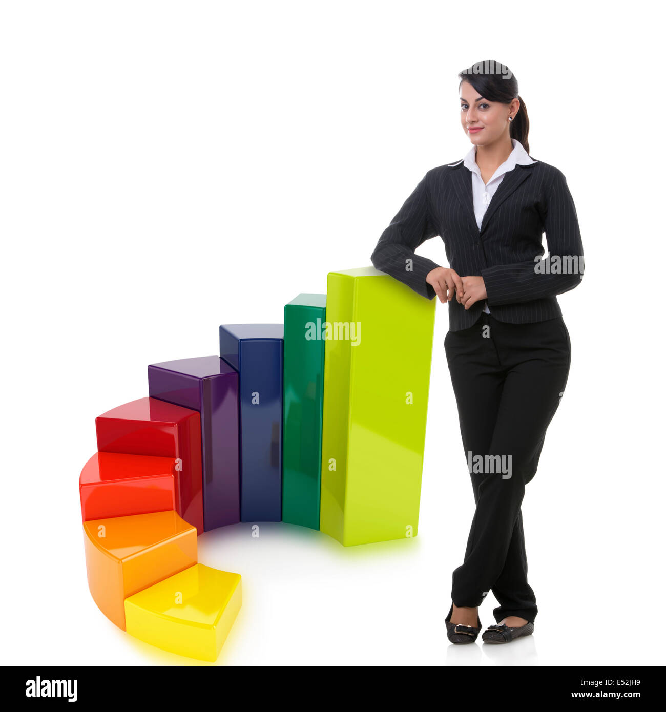 Portrait of well-dressed businesswoman with multi colored bar graph representing growth over white background - Stock Image