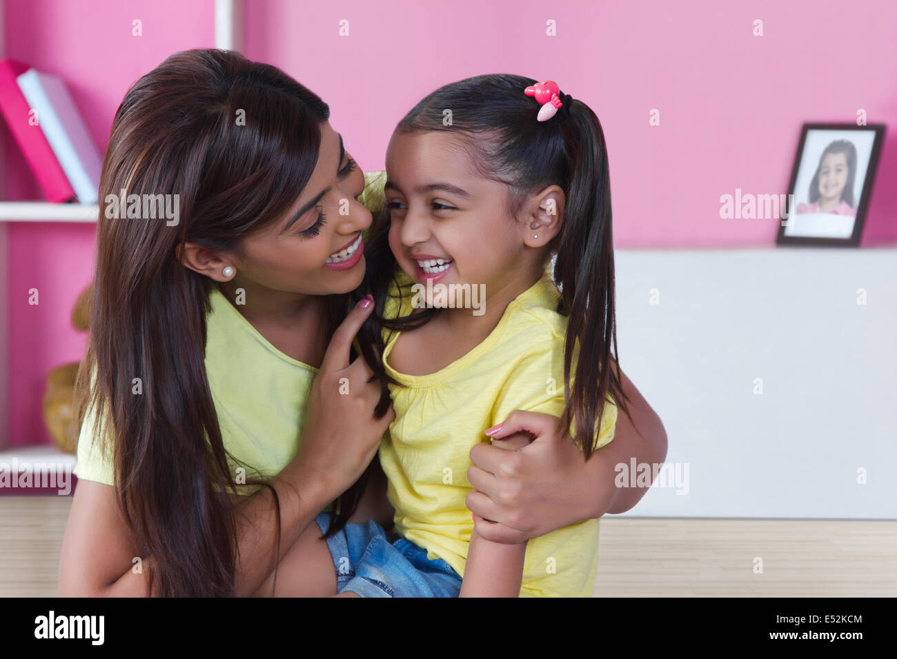 Happy mother and daughter spending leisure time at home - Stock Image