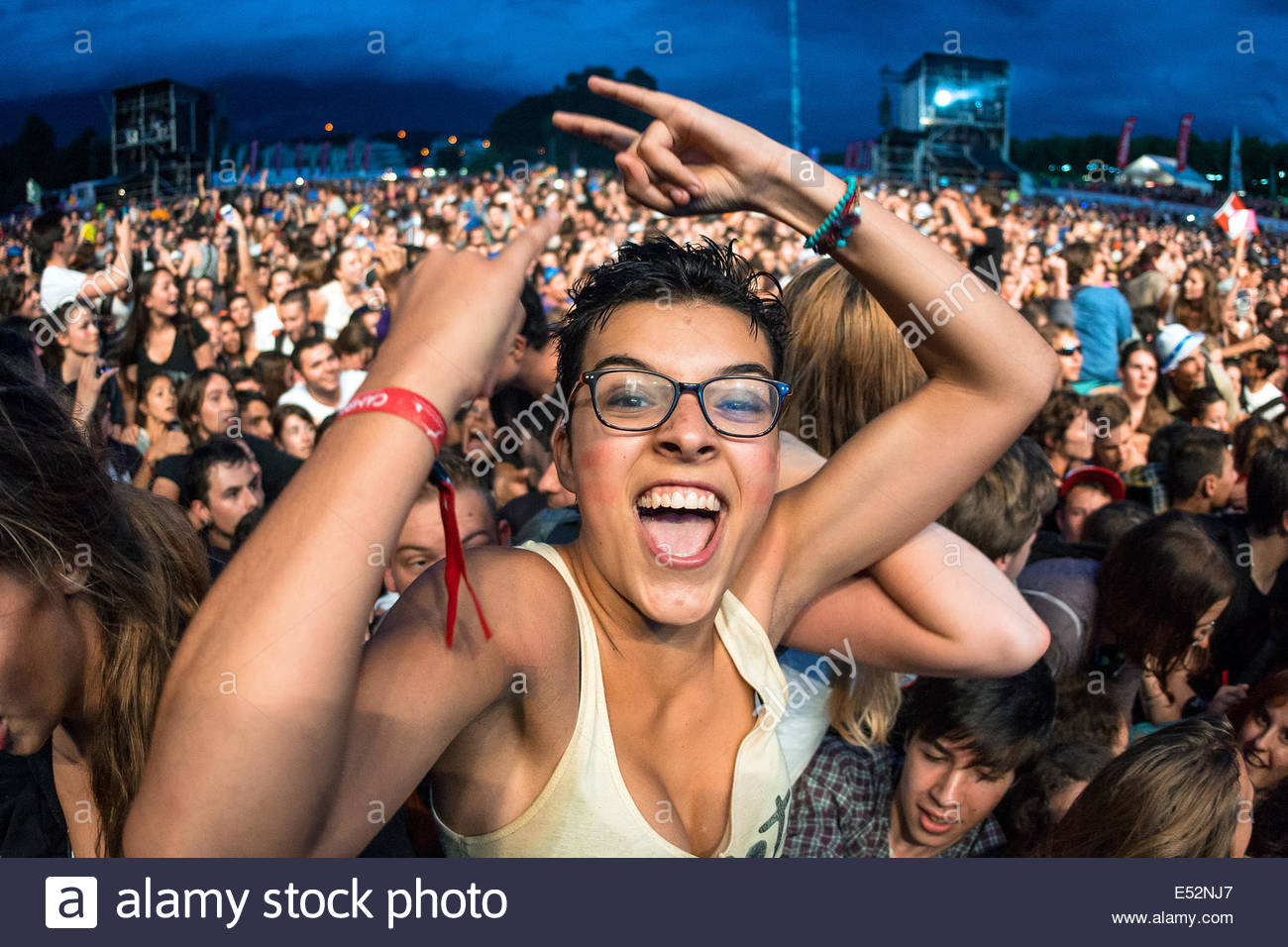 Teenagers cheering at Musilac summer festival in Aix les Bains (France) - Stock Image