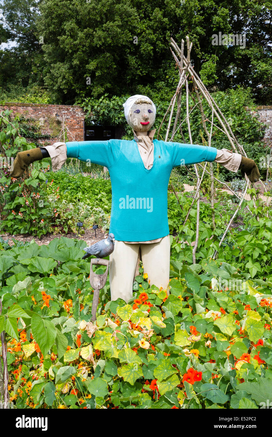 Glamorous lady scarecrow in the garden of an English country house - Stock Image