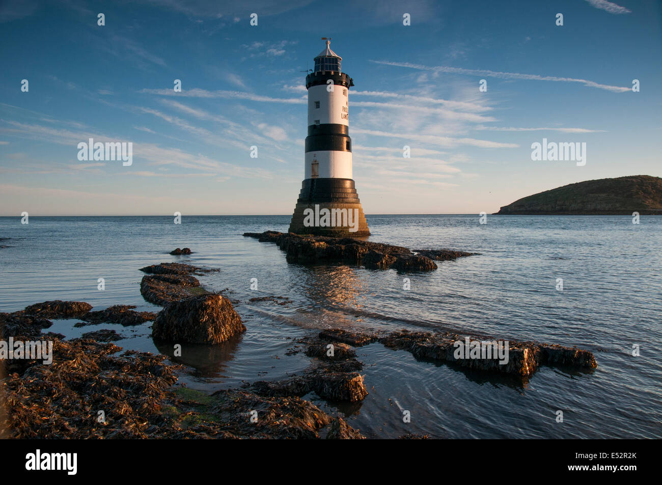 Autumn sunrise at Penmon Lighthouse, Anglesey Wales UK Stock Photo