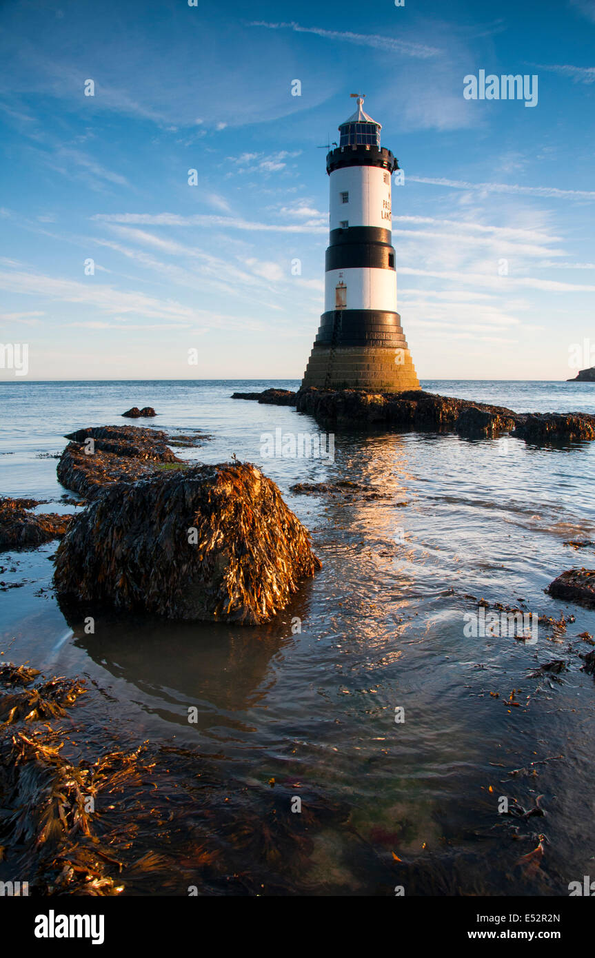 Autumn sunrise at Penmon Lighthouse, Anglesey Wales UK Stock Photo