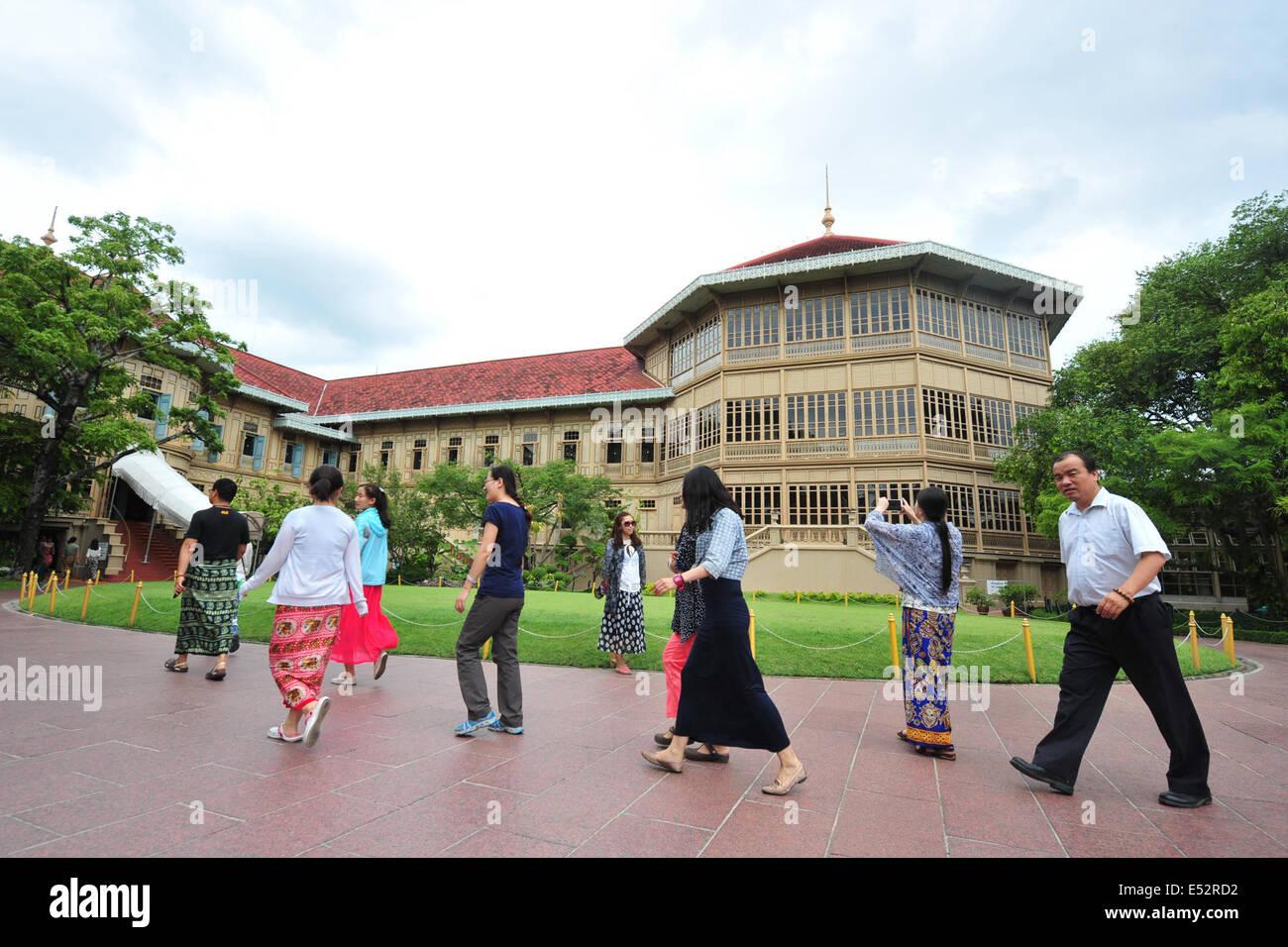 Bangkok, Thailand. 18th July, 2014. Chinese tourists visit the Vimanmek mansion in Bangkok, Thailand, July 18, 2014. - Stock Image