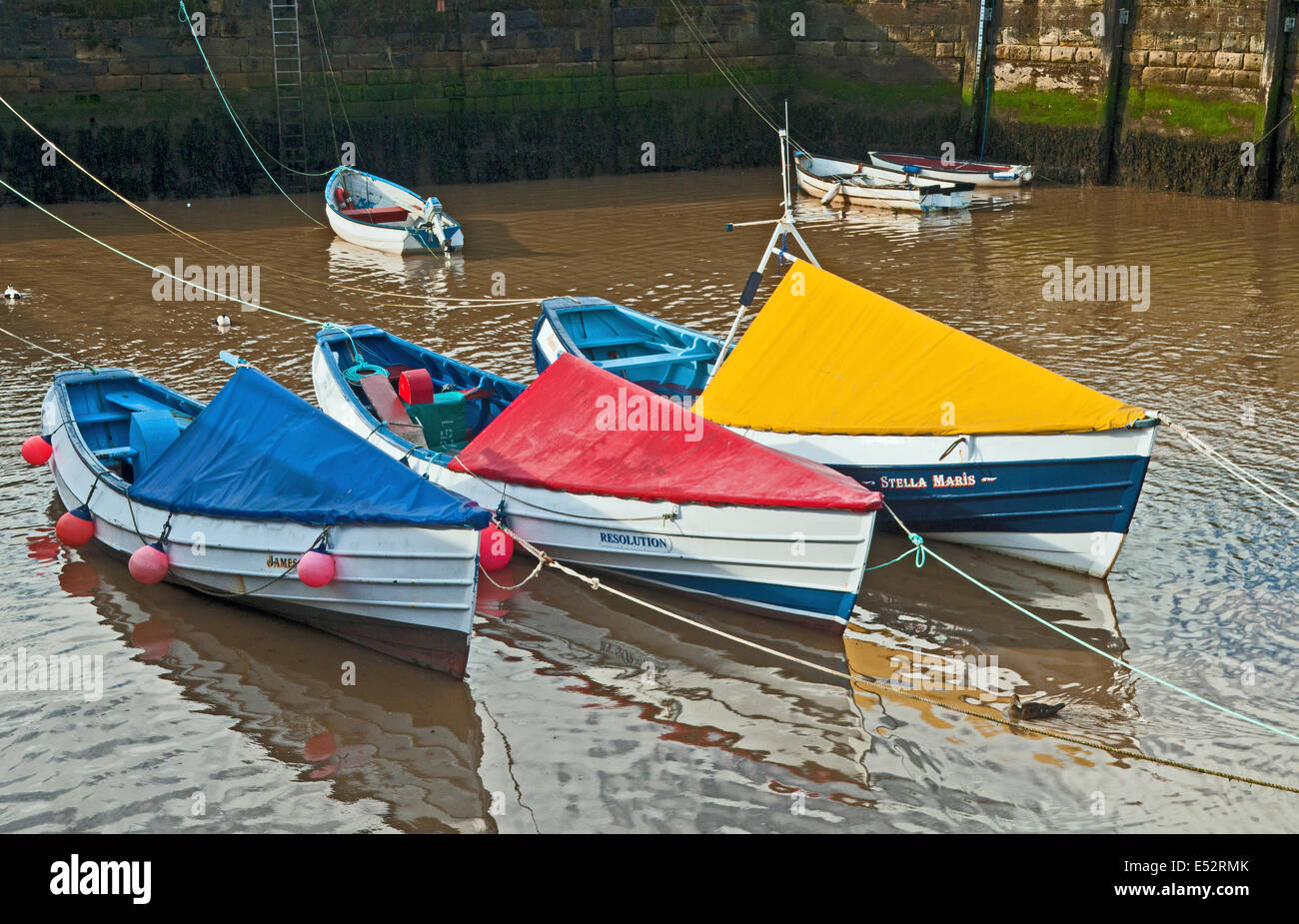 Northumberland Coble Fishing Boats Moored in Amble Harbour Northumberland in the north east of England - Stock Image