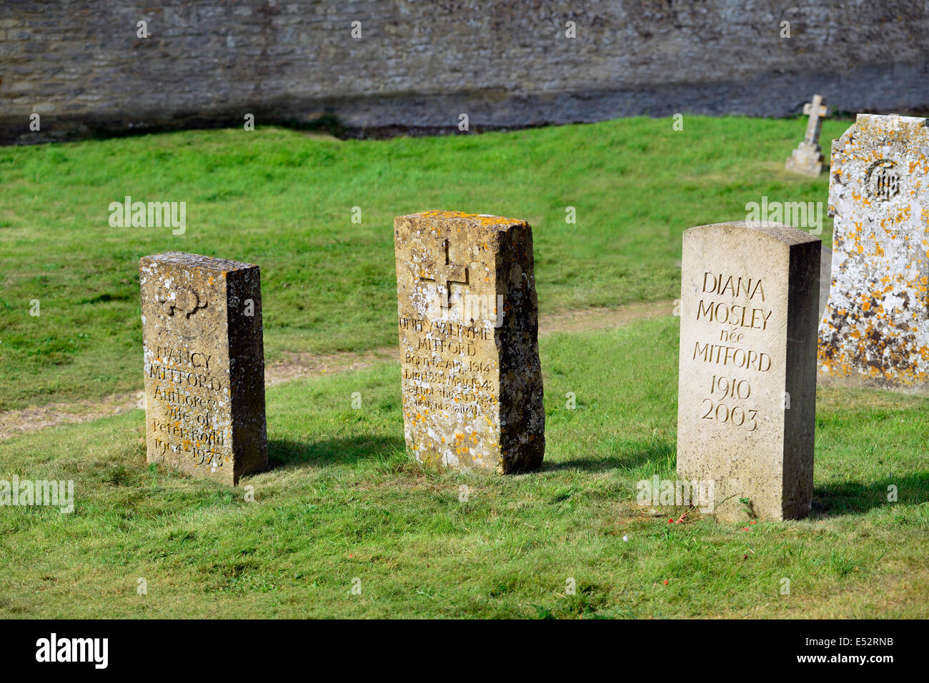 Graves of the three Mitford sisters (Nancy, Unity & Diana)  in Swinbrook Churchyard Oxfordshire. - Stock Image