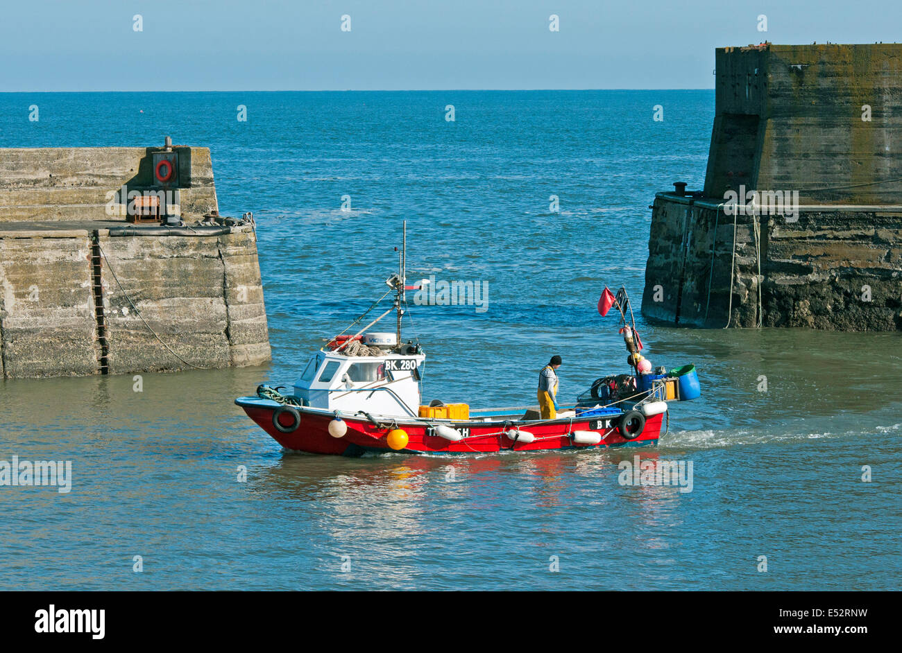Fishing or Crabbing Boat returning to Craster Harbour on the Northumberland Coast after being out fishing - Stock Image