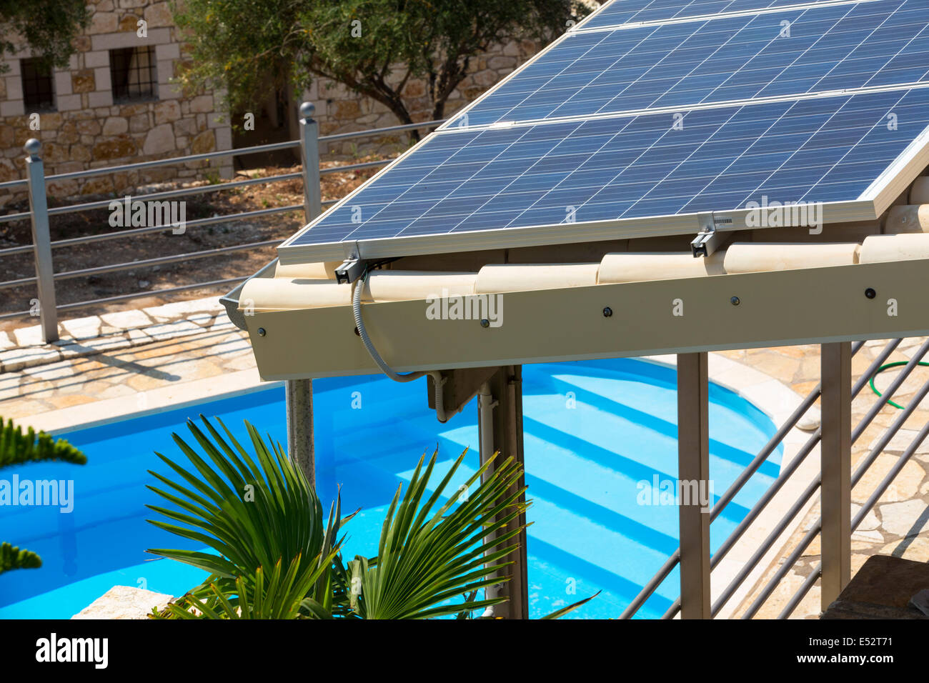 Solar panels on a roof in Sivota, Greece, with a swimming pool Stock ...