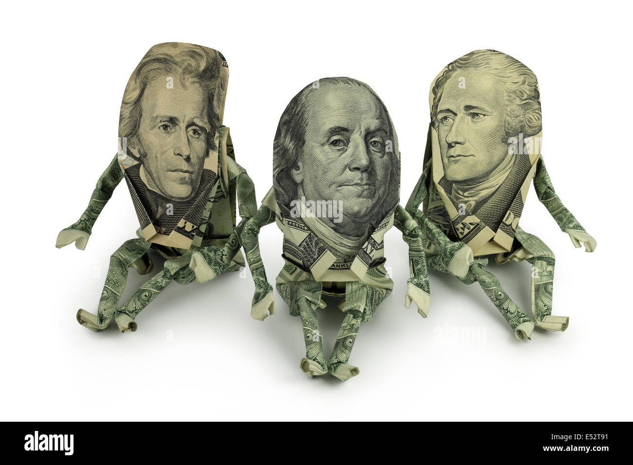 3 Origami human figures made from U.S. Currency with Ben Franklin in the middle. - Stock Image