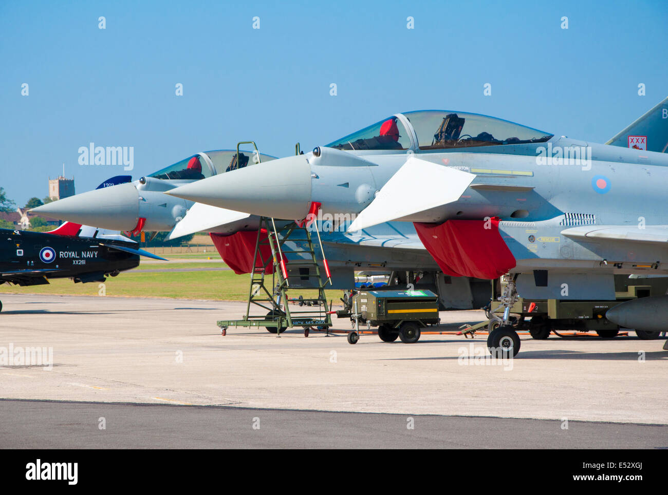 The noses of two Eurofighter Typhoon FGR4 aircraft (parked) with canards angled down and intake covers in place - Stock Image